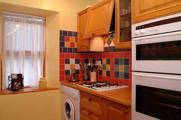 The kitchen is small but well-equipped.