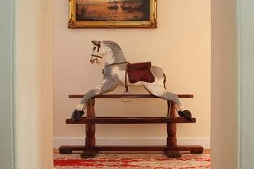 A lovely old rocking horse guards the landing upstairs.
