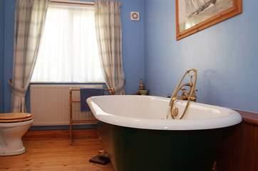 The big claw-foot bath in the bathroom.