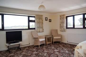 The huge master bedroom has an en suite bathroom and views across the estuary.