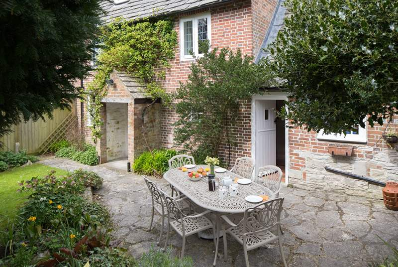 The back of the cottage; doors from both the sitting-room and the kitchen open onto the patio and sheltered garden.