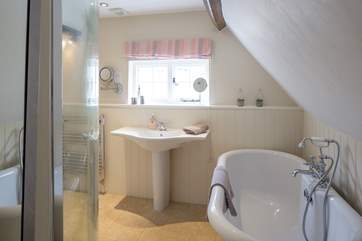 The spacious ensuite for the master bedroom has this wonderful roll-top bath and a separate shower cubicle too.