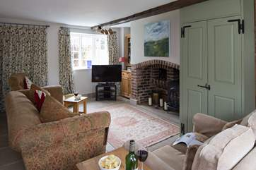 The cosy sitting-room has two sofas, relax with a glass of something delicious and unwind.