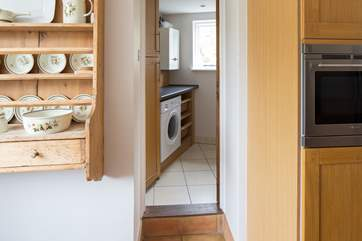 Up one step from the kitchen takes you to the utility room and the downstairs cloakroom.