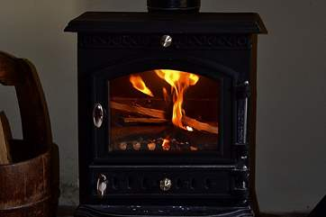 The glowing wood-burner.