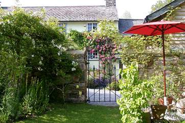 The cottage has its own garden to the right of the lane.