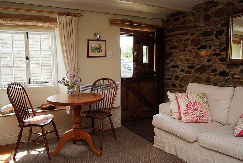 A stable-door opens into this lovely cottage.
