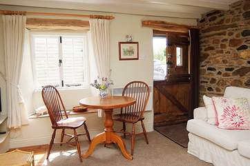 A stable-door opens into this lovely cottage, and a deep sofa to snuggle up in welcomes you on arrival.