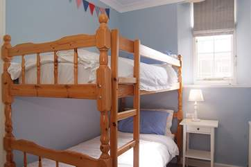 The cosy bunk-room is ideal for children.