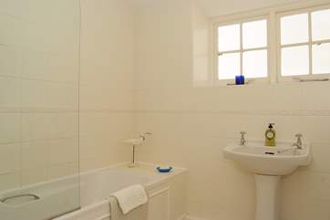 The bathroom has a fitted shower over the bath.