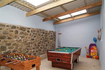 The games-room includes an air hockey table, table-football, a pool table and a dart board.