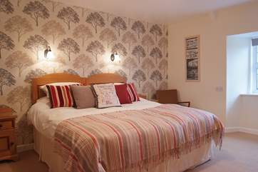 The stunning master bedroom has a super king size bed (6') and en-suite shower room.