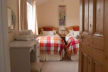The twin bedroom (bedroom 2) is on the half landing and overlooks the farm courtyard.