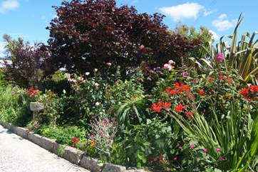 The flower borders are full of colour in summer.