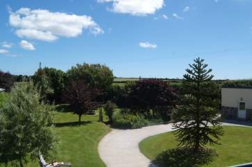 The view across the garden from the master bedroom's window, with the games-room on the right.