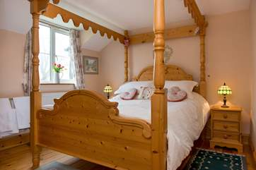 The gorgeous four poster bed in bedroom 2.