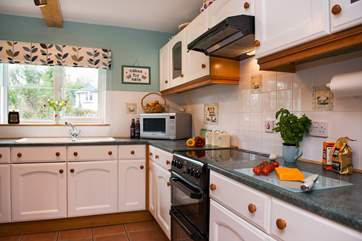 The kitchen is well equipped and is very much the heart of the home.