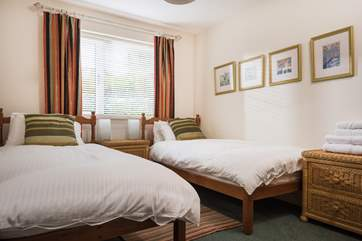 Bedroom 3 is furnished with twin beds.
