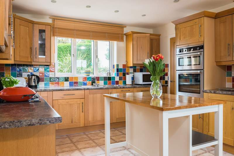 The wonderfully spacious kitchen has a utility 'cupboard' next door, which houses the washing machine and tumble-drier.