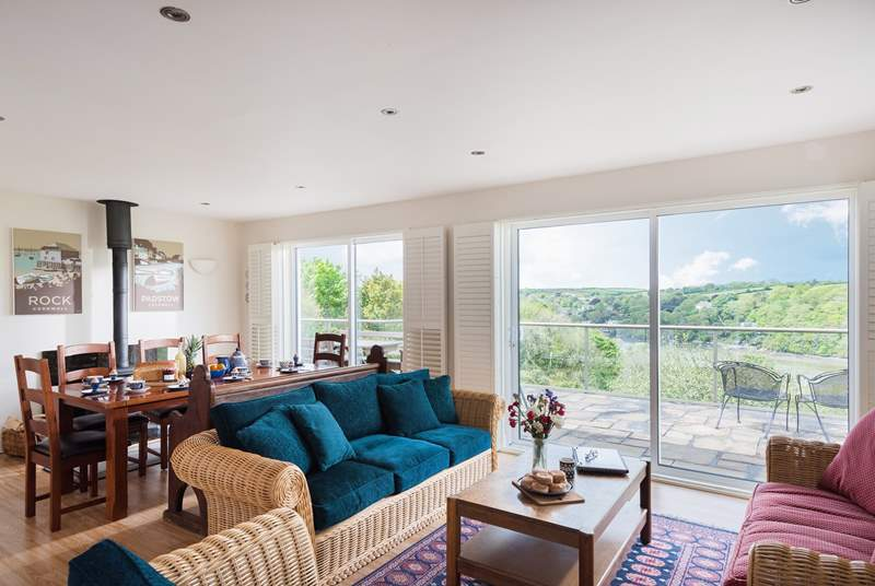 The big kitchen/dining-room also has a sitting-area, with two patio doors making the most of the glorious views.