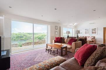 The enormous main sitting-room is hugely spacious and filled with natural light.