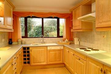 The well appointed kitchen has views of the garden.
