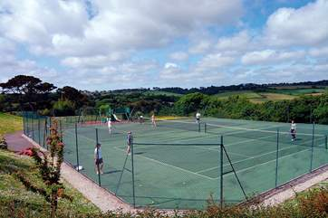 The tennis courts are surrounded by wonderful views.