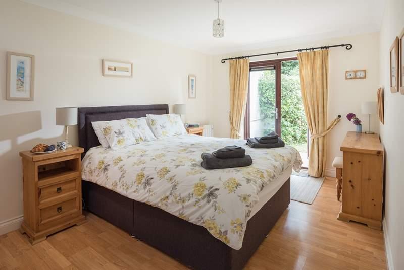 The master bedroom (Bedroom 1) has double doors opening to the garden.
