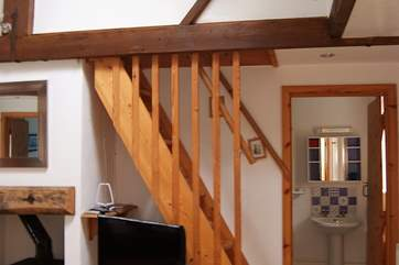 The first floor twin bedroom (Bedroom 3) is accessed by steep ladder-style stairs from the living-room.