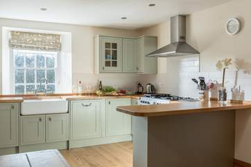 The spacious kitchen/dining-room is a delight.