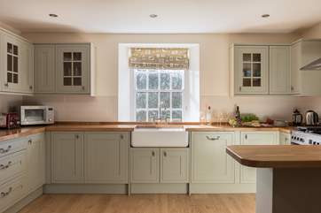The lovely Shaker-style kitchen area looks out over the garden.