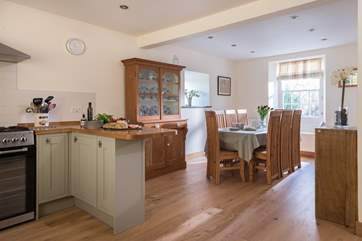 The dining area in the dual aspect kitchen/dining-room.