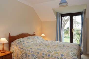 The master bedroom has a king size bed and a Juliette balcony (Bedroom 1).