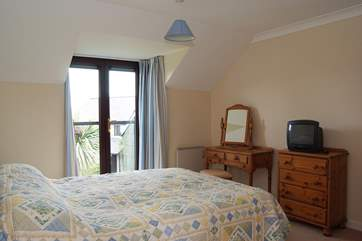 The double bedroom has its own television and en suite shower-room.