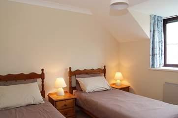 Cosy twin beds in Bedroom 3.