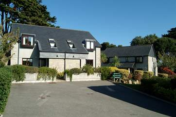 Rosemary Cottage is the right-hand property of the semi-detached houses on the left.
