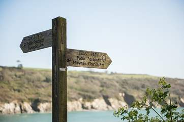 The coast path is just at the bottom of the hill.