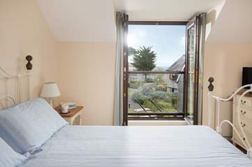 The master bedroom (Bedroom 1) has a Juliette balcony with fabulous views).