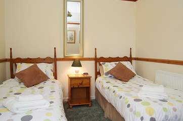 The twin bedroom on the ground floor overlooks the garden to the front.