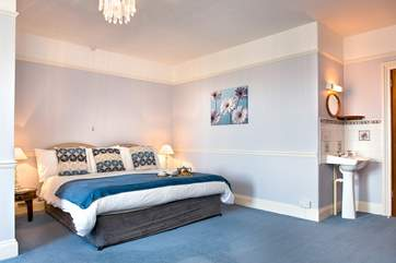 The master bedroom is huge and has a comfy super kingsize bed