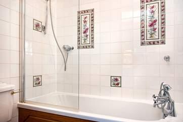 The master bedroom has an en-suite bathroom