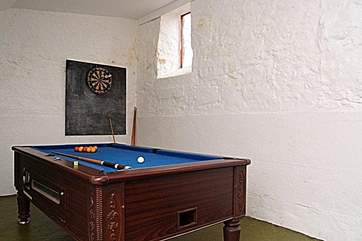 The coin-operated pool table in the outside games-room.