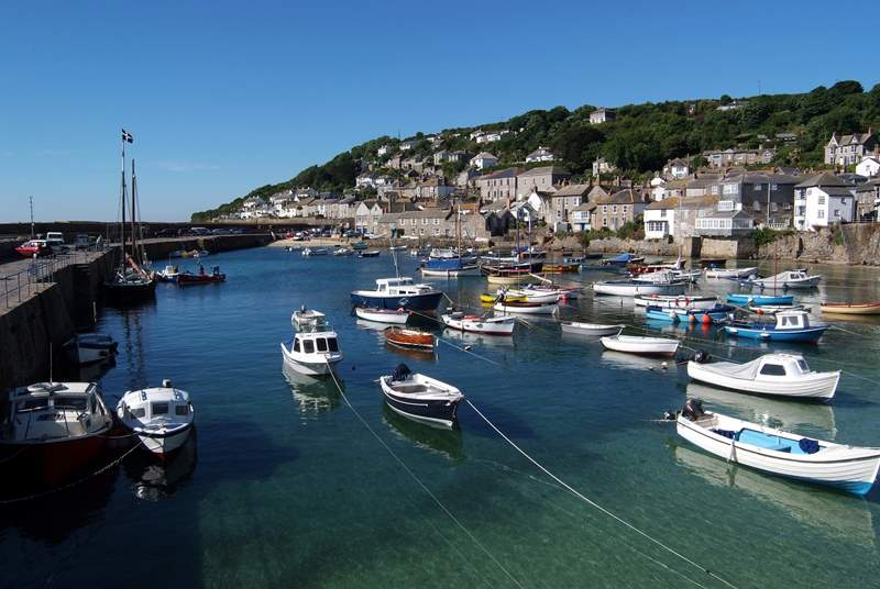 Mousehole Harbour is just three miles away.