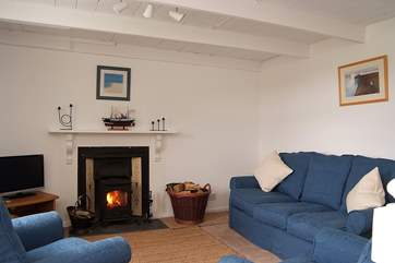 The cosy sitting-room with its traditional beamed ceiling.