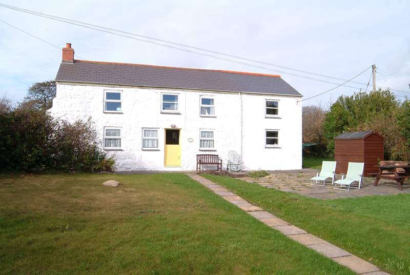 The front of Yellow Blossom Cottage and its garden.