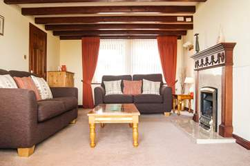 Comfortable sofas, a coal-effect gas fire and Sky TV...all perfect for family film nights.