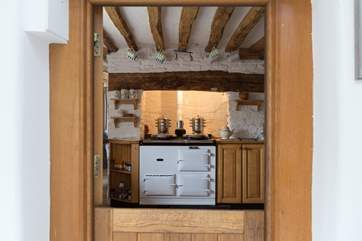 A boot-room with a stable-door leads through to the kitchen with its warming Aga.