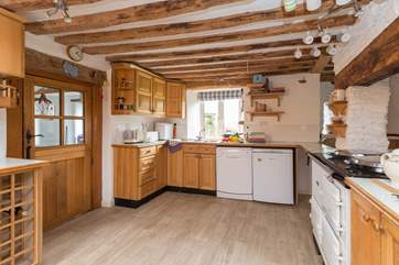There is a large farmhouse-style kitchen.