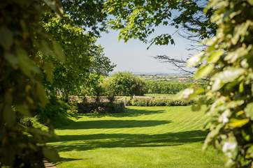 The enclosed garden comprises an acre of lawn and trees.