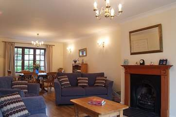 The spacious reception room with patio doors.